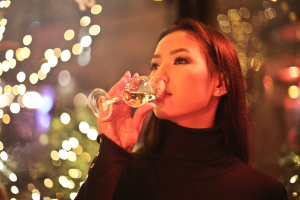 A woman drinking white wine